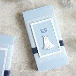 Winterliche Schiebeverpackung mit Eisbär
