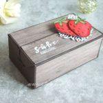 Perfekte Päckchen gefüllt mit süßen Erdbeeren